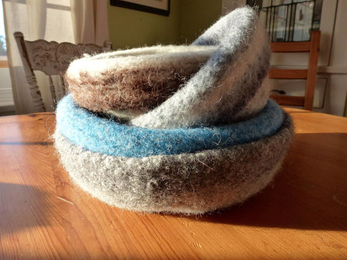 A photo of a stack of felted bowls