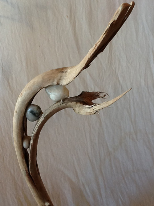 A sculpture made from driftwood and stones