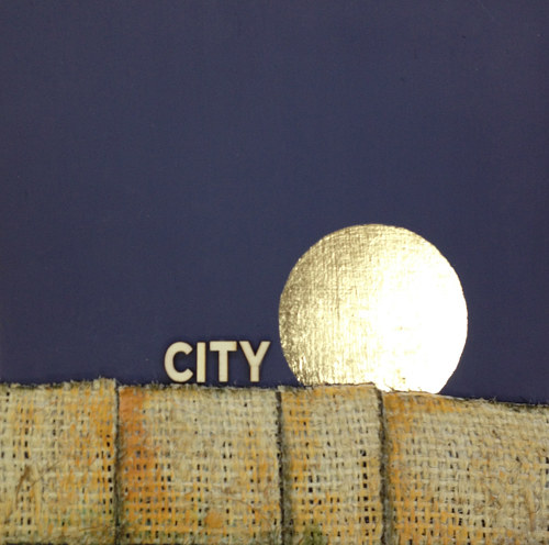 A mixed media artwork of an abstracted city