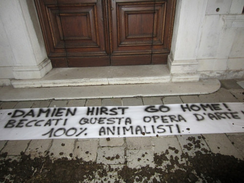 A message left by an animal rights group outside a Damien Hirst show in Venice
