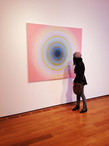 woman looking at an artwork