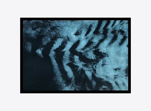 An abstract print with blue and black tones