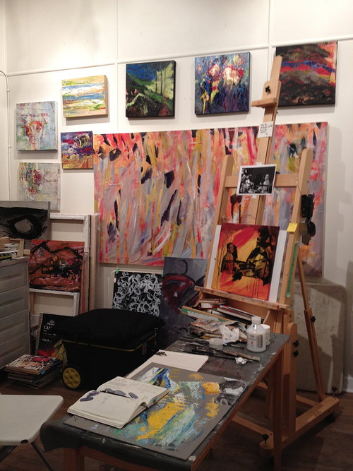 Photo of artist studio with paintings