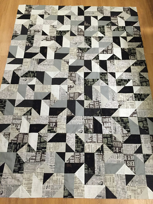 A quilting project with a black and white geometric pattern