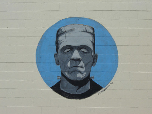 A mural painting of Frankenstein on the exterior of a costume shop