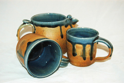 A selection of gold and blue glazed ceramic cups