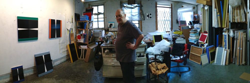 A panoramic photo of Don Voisine in his studio by Paul D'Agostino