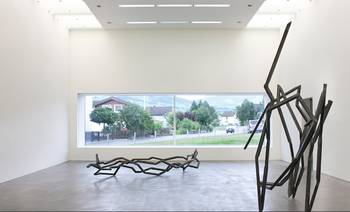 An installation view of two Robert Schad sculptures in a gallery