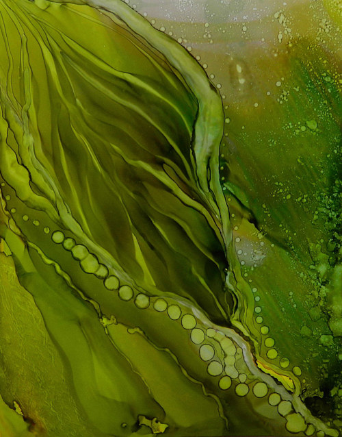 An alcohol ink paper primarily in green tones