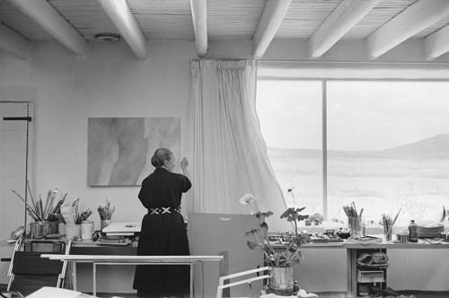 A photo of Georgia O'Keeffe working in her studio