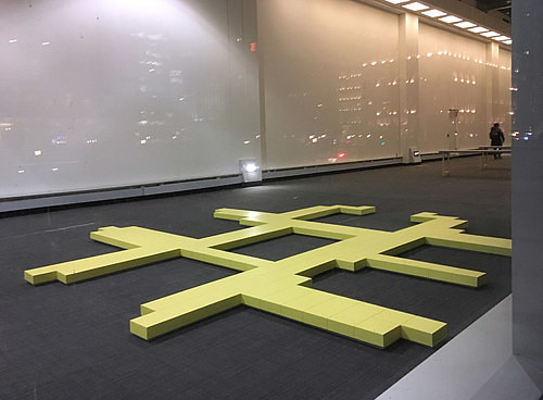 A photo of a floor-based installation artwork installed in a gallery