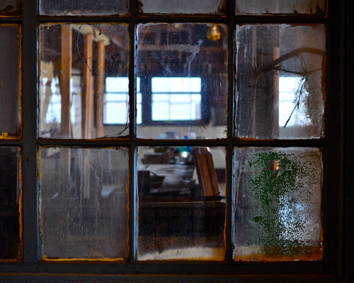 A photo of an abandoned window in Central Falls, Rhode Island