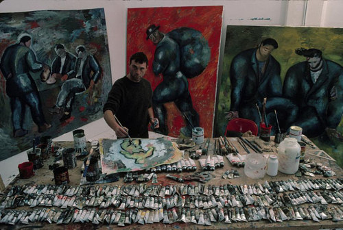 A photo of Sandro Chia working on a painting in his studio