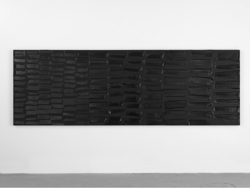 A large horizontal painting in textured black