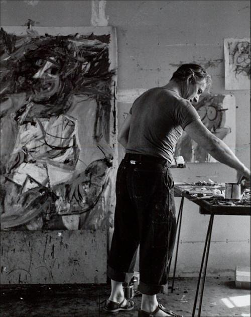 Photo of artist mixing painting in art studio