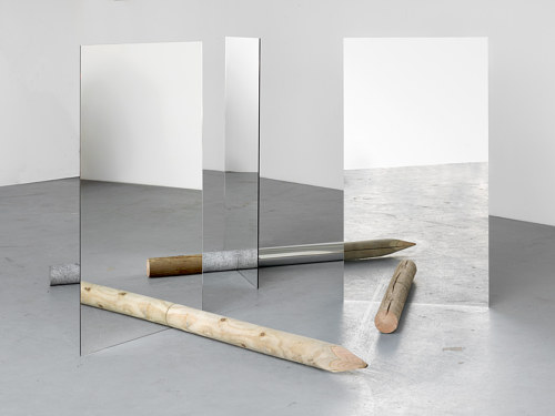 A photo of a sculpture made with mirrors and raw wood