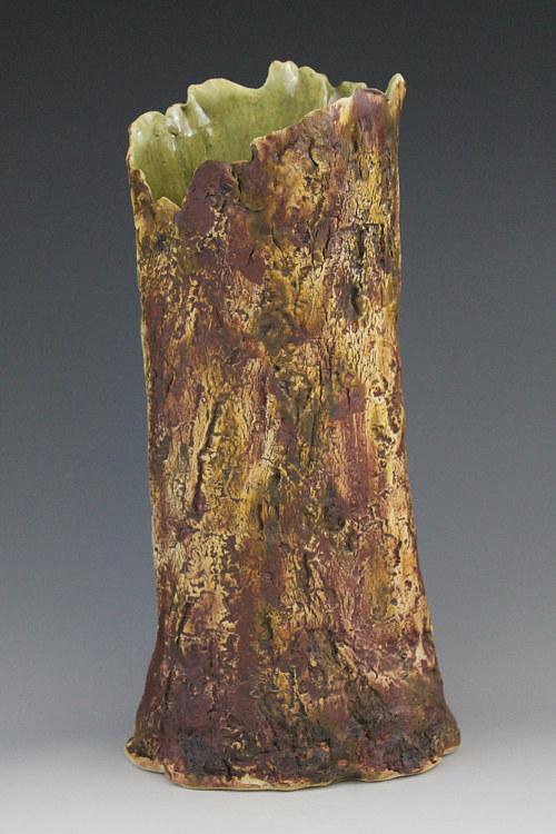 A handmade vase shaped like a tree trunk
