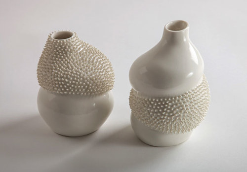 A set of ceramic vases with contrasting textures
