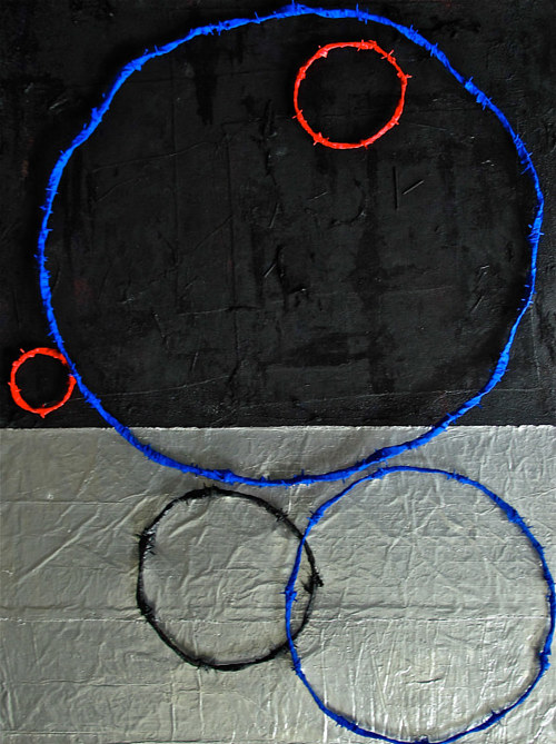 A mixed media artwork with circles and a two-tone background