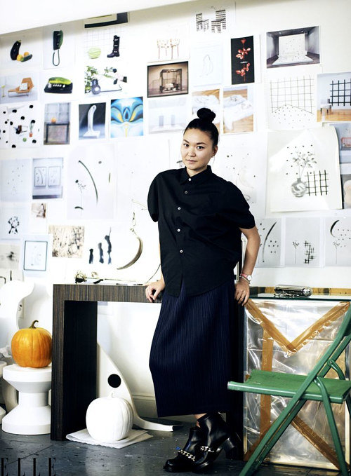 A photo of Margaret Lee standing in her studio