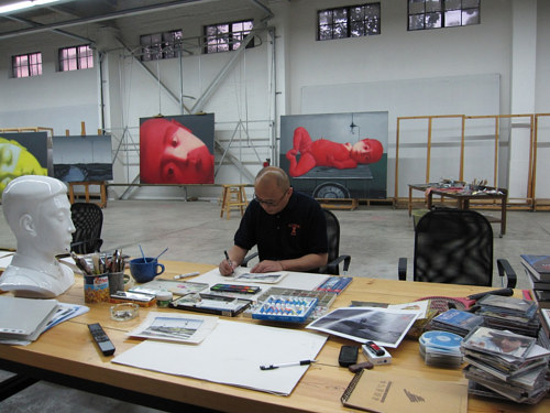 A photo of Zhang Xiaogang in his studio in Beijing