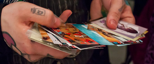 Photo of hands holding multiple cards