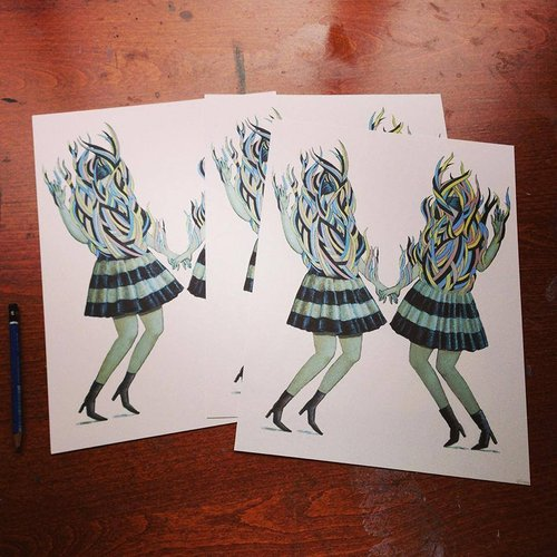 Photo of artist prints girls with dresses and flames