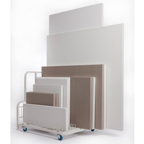 Photo of various stretched canvases on cart