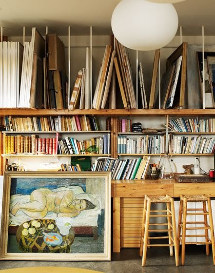Photo of paintings and books stored in art studio