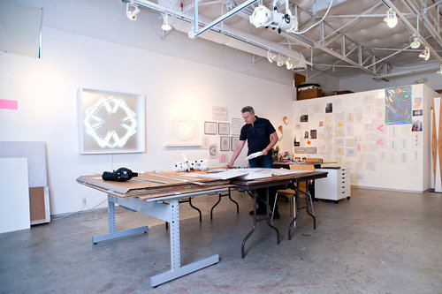 Photo of artist in studio working