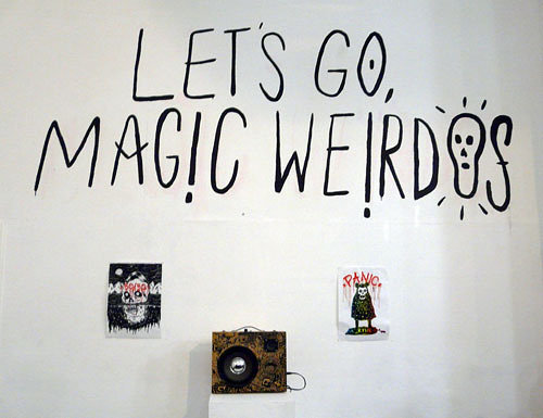 Photo of text on the wall Let's Go Magic Weirdos