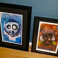 Blue Skull (original art) and Tribal Warrior (print) Framed by Joey Feldman