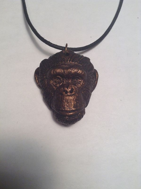 Toby chimpanzee pendant bronze finish by Jason  Shanaman