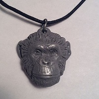 Topo chimpanzee pendant chimps inc.  light cold cast pewter by Jason  Shanaman
