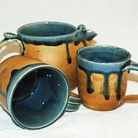 Gold blue cups by Jack Caselles