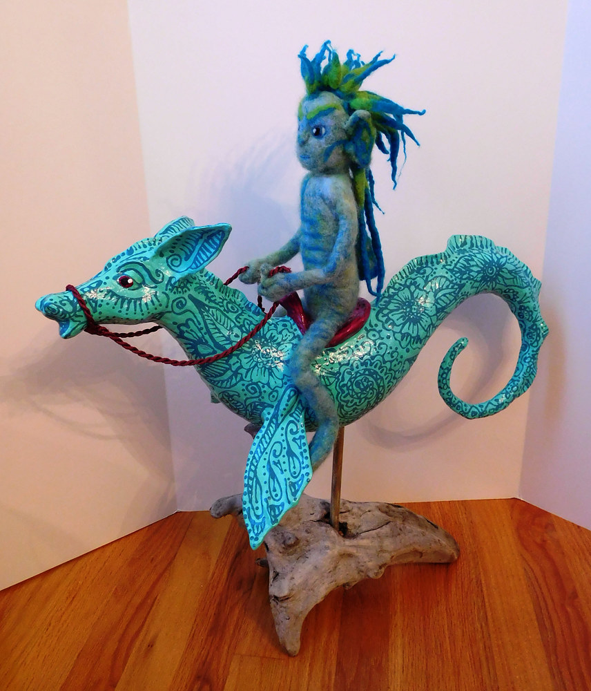 Drawing Sea Sprite on a seahorse by Valerie Johnson