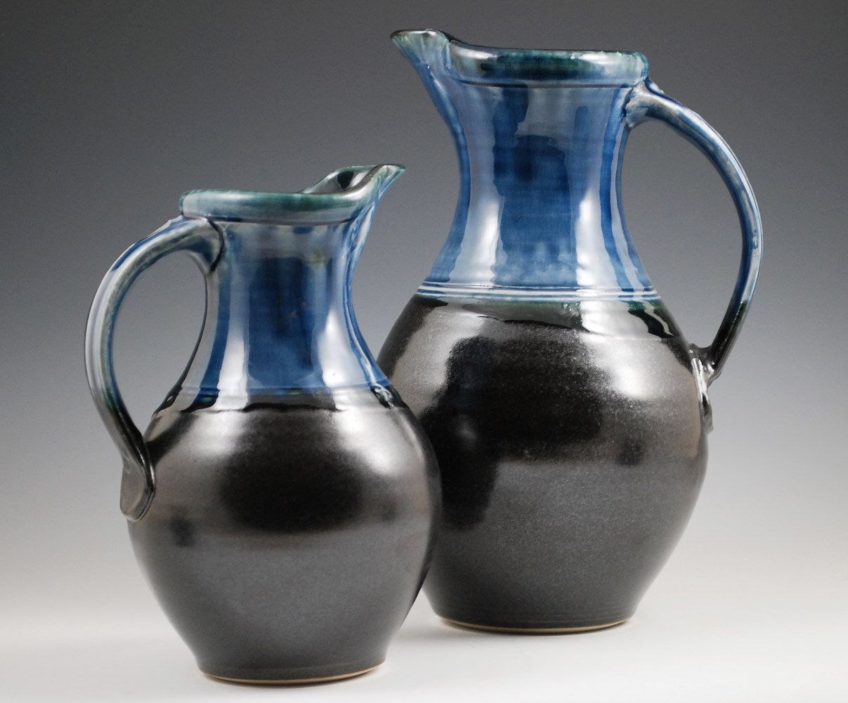Blue Ash Pitchers with Black on Bottom by Mark  Goertzen