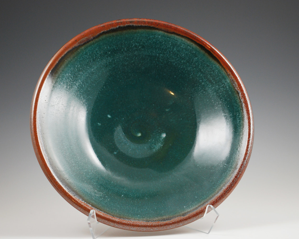 Verdant Serving Bowl with Rust Red rim by Mark  Goertzen