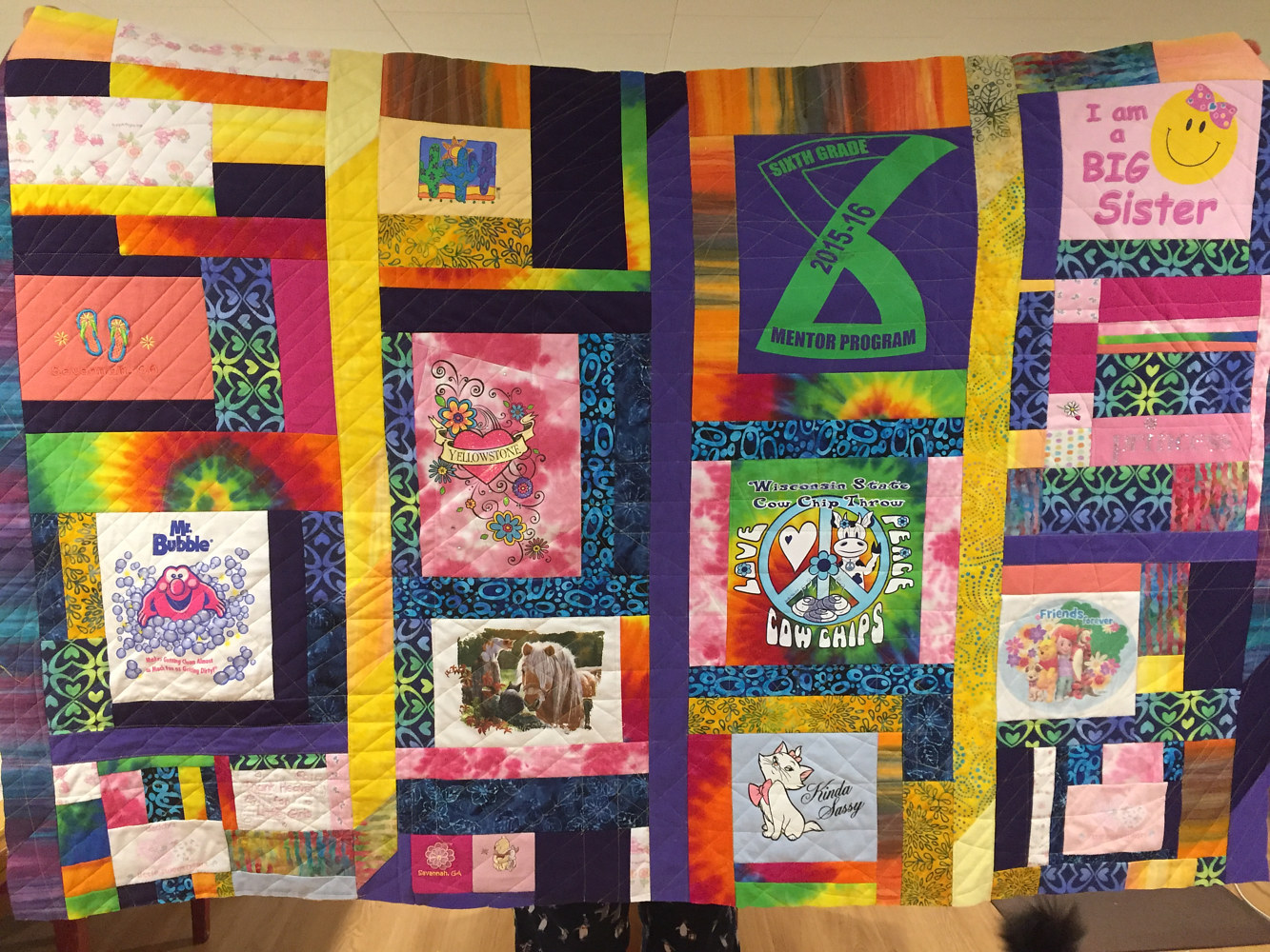 Upcycled clothing quilt, from mom to daughter, April 2017 by Maday Delgado