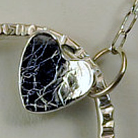 whimsical sterling silver pendant by Vicki Allesia
