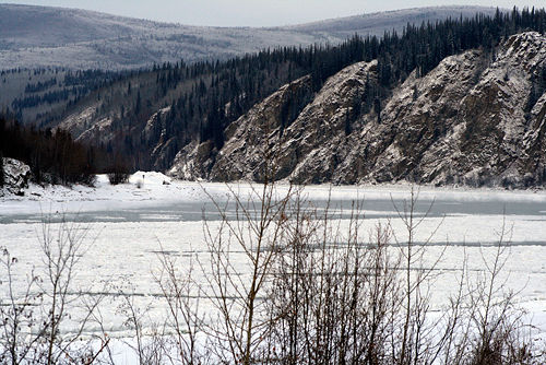 Klondike River almost frozen over by Belinda Harrow