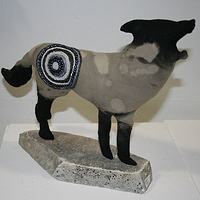 """Beaded Wolf II"" 2010. Cotton, embroidery thread, beads and stone. 30 x 22 x 12 cm by Belinda Harrow"