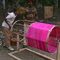 vendors preparing the kite string on the street of Ahemdebad for the upcoming Kite Festival by Belinda Harrow