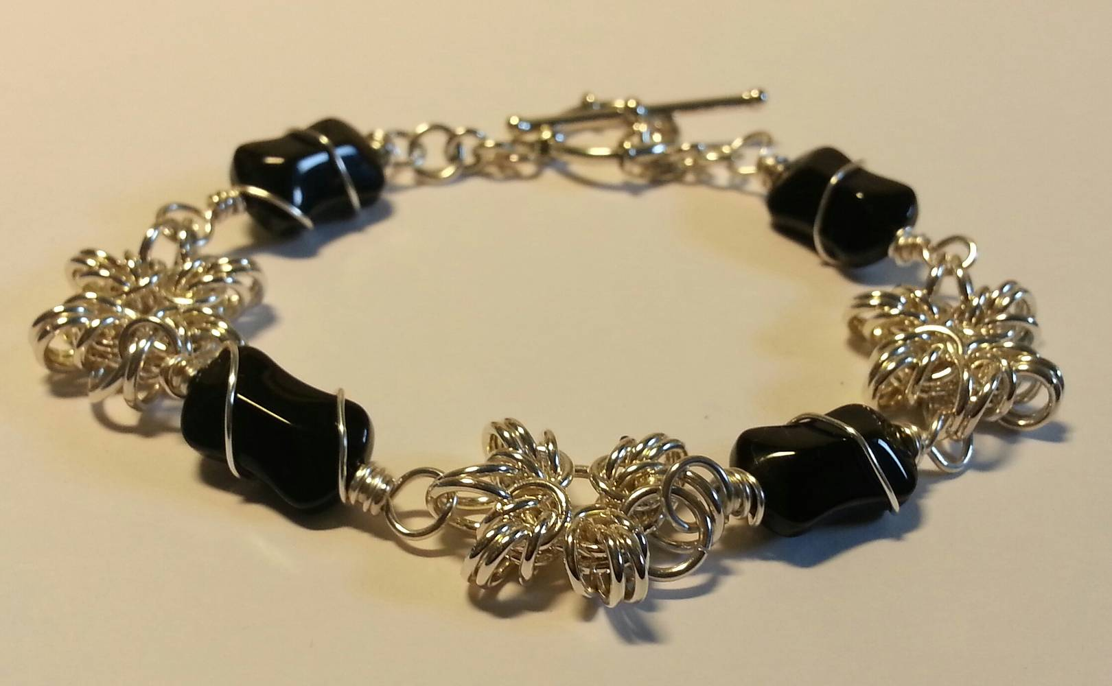 SS chainmaille and black polished glass beads bracelet by Vicki Allesia
