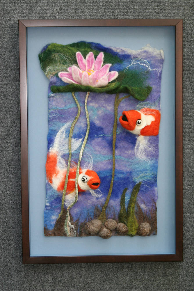 Koi under the lillies  by Valerie Johnson