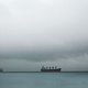 Freighters Under Cloud by Jim Friesen