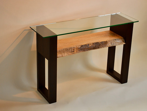 A hand-made console table with wood and glass elements