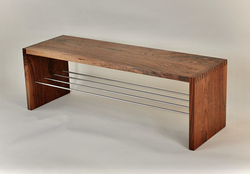 A bench made from walnut and metal