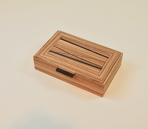 A custom-made box of zebra wood and ebony