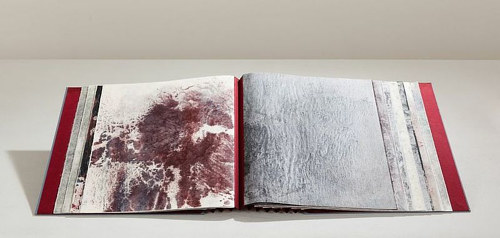 A handmade artist book with abstract imagery on the pages